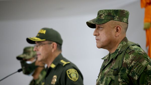 Commander of the Colombian Military Forces, General Luis Fernando Navarro listens as Colombia's National Police Director General Jorge Luis Vargas speaks during a news conference about the participation of several Colombians in the assassination of Haitian President Jovenel Moise, in Bogota, Colombia July 9, 2021. - Sputnik International