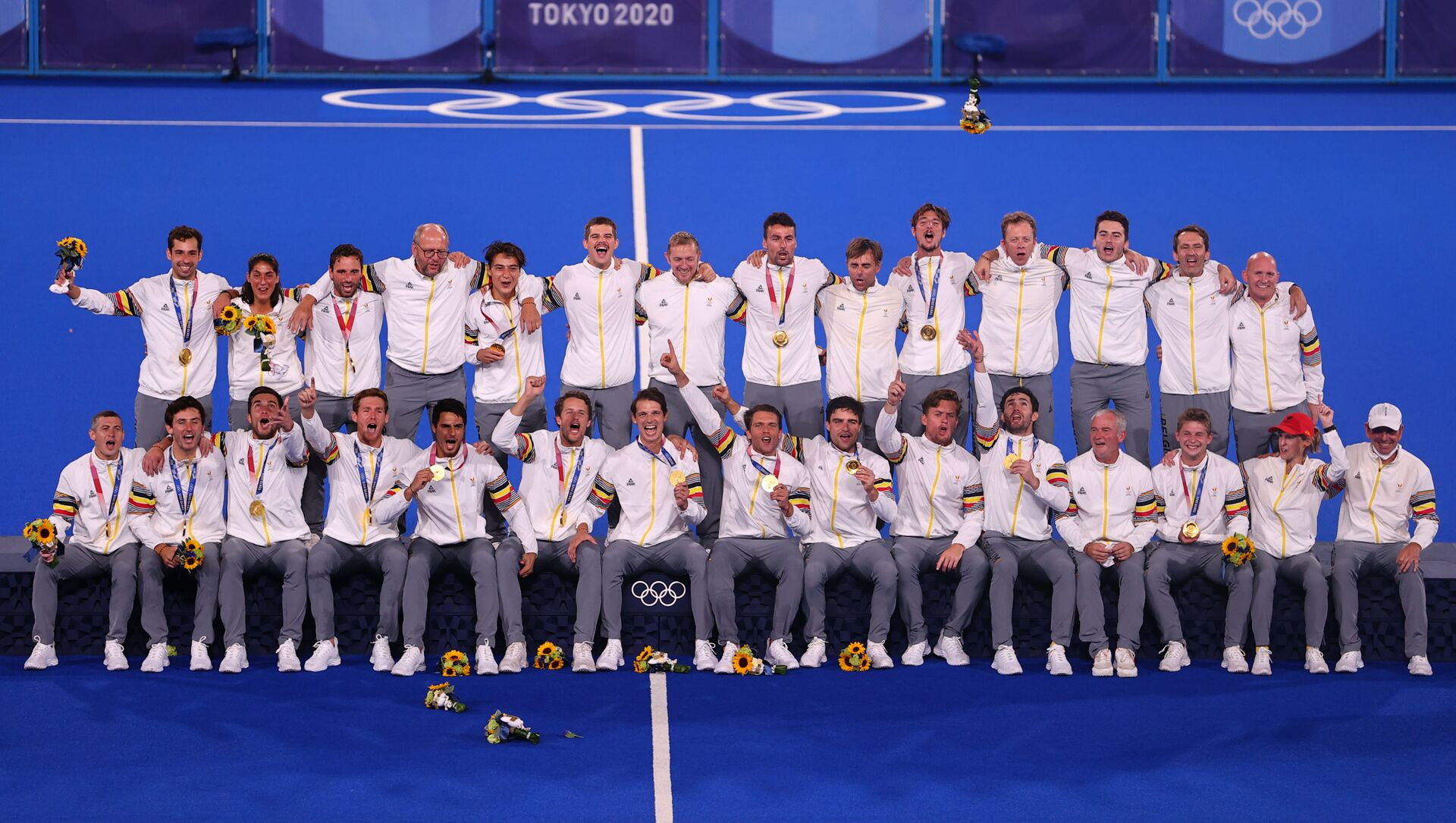 The players and staff of Belgium celebrate as they pose for pictures on the podium after receiving their gold medals.  - Sputnik International, 1920, 05.08.2021