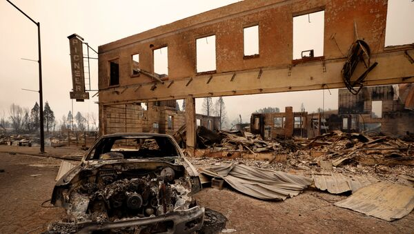 View of a burned out car and commercial building following the Dixie Fire, a wildfire that tore through the town of Greenville, California, U.S. August 5, 2021. - Sputnik International