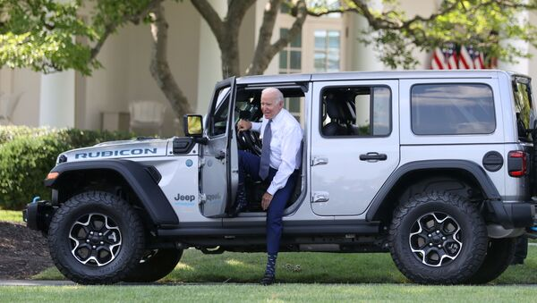 U.S. President Joe Biden hops out after test driving a Jeep Wrangler 4xe Rubicon during an event for clean cars and trucks, and signs an executive order on transformaing the country's auto fleet at the White House in Washington, U.S. August 5, 2021. - Sputnik International