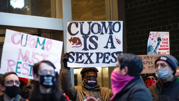 People attend a protest to demand New York Governor Andrew Cuomo's resignation after a third woman accused him of sexual harassment in New York City on March 2, 2021. - - Sputnik International