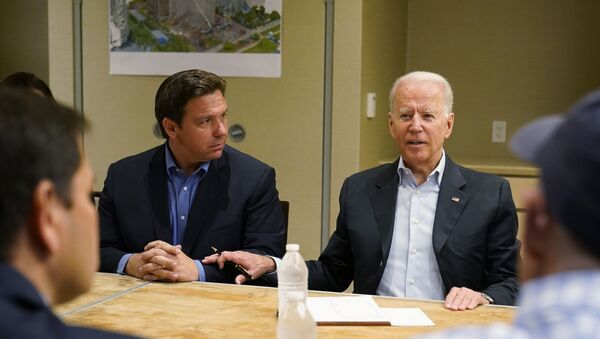 President Joe Biden, right, speaks as Florida Gov. Ron DeSantis, left, listens during a briefing with first responders and local officials in Miami Beach, Fla., Thursday, July 1, 2021, on the condo tower that collapsed in Surfside, Fla., last week. - Sputnik International