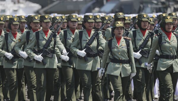 Women soldiers march during a parade marking the 74th anniversary of the Indonesian Armed Forces in Jakarta, Indonesia, Saturday, Oct. 5, 2019.  - Sputnik International