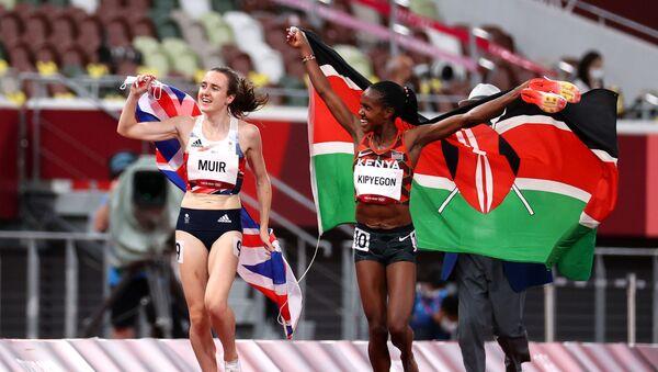 Tokyo 2020 Olympics - Athletics - Women's 1500m - Final - Olympic Stadium, Tokyo, Japan - August 6, 2021. Gold medallist Faith Kipyegon of Kenya celebrates with silver medallist, Laura Muir of Britain - Sputnik International