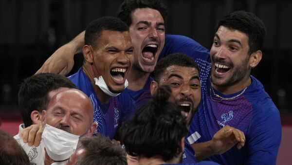 Team France celebrates winning the men's volleyball gold medal match against the Russian Olympic Committee, at the 2020 Summer Olympics - Sputnik International