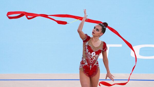 Russian Olympic Committee's Dina Averina performs with the ribbon in the rhythmic gymnastics individual all-around final at the Tokyo 2020 Olympic Games at Ariake Gymnastics Centre in Tokyo, Japan. - Sputnik International