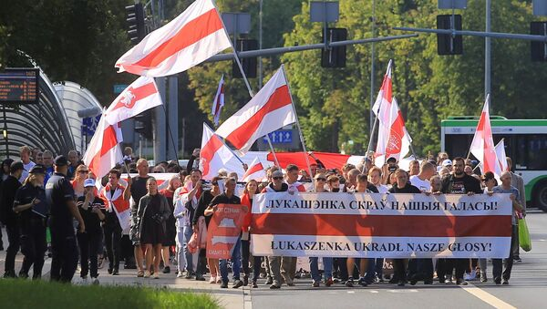 People march at the Global Solidarity Event for Belarus protest in Bialystok, Poland August 8, 2021 - Sputnik International