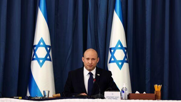 Israeli Prime Minister Naftali Bennett speaks at the weekly cabinet meeting at the Foreign Ministry in Jerusalem August 8, 2021. REUTERS/Ronen Zvulun/Pool - Sputnik International