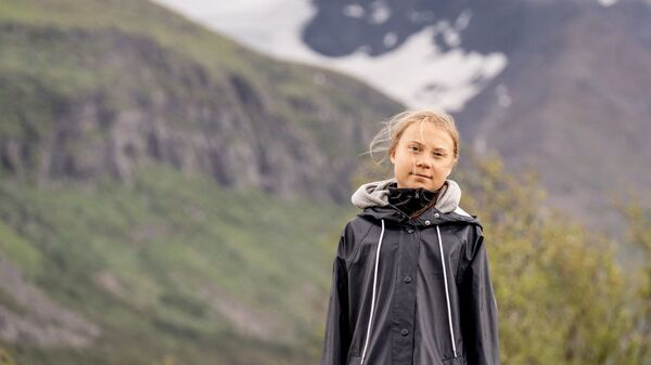 Swedish climate activist Greta Thunberg poses for a photo by the Ahkka mountain at the world heritage site of the Laponia area in Sapmi on July 13, 2021. - Sputnik International