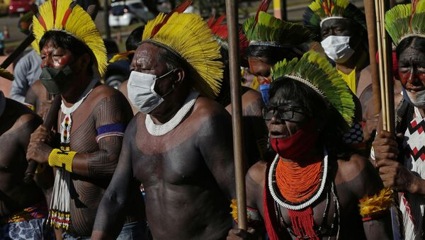 Indigenous people march to the entrance of the Chamber of Deputies to protest against Brazilian President Jair Bolsonaro's proposals to allow mining on Indigenous lands in Brasilia, Brazil, Wednesday, June 16, 2021 - Sputnik International
