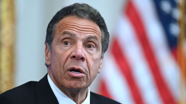 In this file photo Governor of New York Andrew Cuomo speaks during a press conference at the New York Stock Exchange (NYSE) on May 26, 2020 at Wall Street in New York City. - Sputnik International