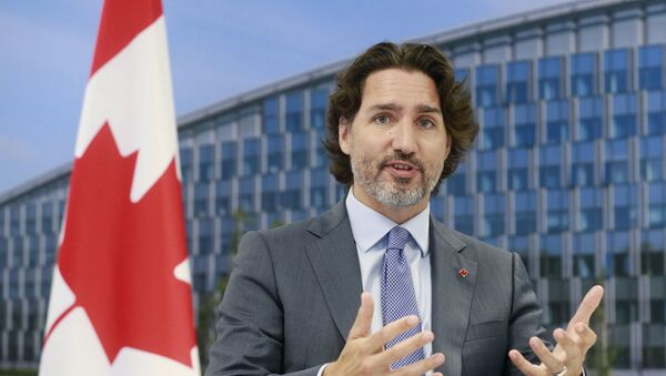 Canada's Prime Minister Justin Trudeau  speaks to the NATO Secretary General during a NATO summit at the North Atlantic Treaty Organization (NATO) headquarters in Brussels on June 14, 2021.  - Sputnik International