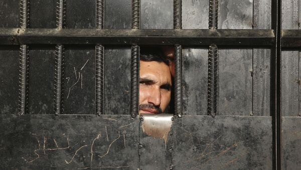 Taliban prisoners watch through the door inside a prison after an attack in the city of Jalalabad, east of Kabul, Afghanistan, Monday, Aug. 3, 2020. - Sputnik International