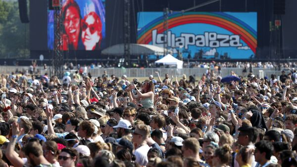 In this July 29, 2021 file photo, fans gather and cheer on day one of the Lollapalooza music festival at Grant Park in Chicago. Chicago health officials on Thursday, Aug. 12, 2021, reported 203 cases of COVID-19 connected to Lollapalooza, casting it as a number that was anticipated and not yet linked to any hospitalizations or deaths - Sputnik International