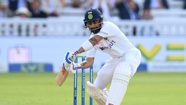 India's captain Virat Kohli plays a shot on the first day of the second cricket Test match  between England and India at Lord's cricket ground in London on August 12, 2021.  - Sputnik International
