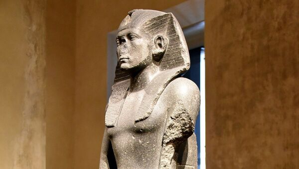 Praying statue of Amenemhat III. The back pillar is inscribed with a hieroglyphic text with the cartouches of the pharaoh. From Memphis, Egypt. Middle Kingdom, 12th Dynasty, c. 1840-1800 BCE. Neues Museum, Berlin, Germany. Dolerite, ÄM 1121 - Sputnik International