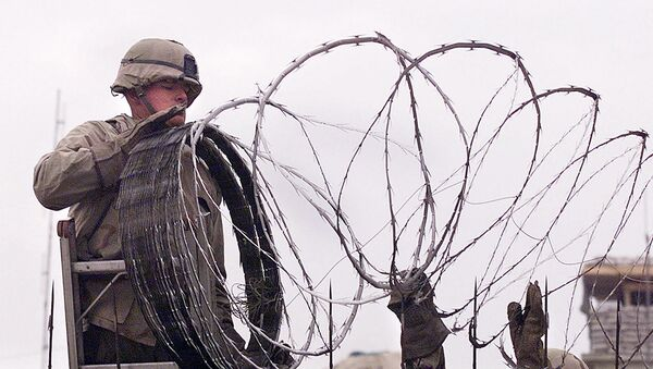 In this file photo a US Marine is given a hand using barbed wire to secure the walls the US embassy in Kabul on January 11, 2002. - The United States said on August 12, 2021 it was sending troops to the international airport in Afghanistan's capital Kabul to pull out US embassy staff as the Taliban makes rapid gains.We are further reducing our civilian footprint in Kabul in light of the evolving security situation, State Department spokesman Ned Price told reporters.This president prioritizes above all else the safety and security of Americans who are serving overseas, he said of Joe Biden, who has ordered a withdrawal of US troops from Afghanistan after nearly 20 years. - Sputnik International