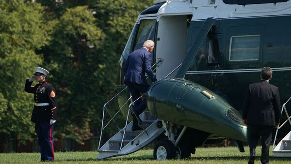 US President Joe Biden makes his way to board Marine One before departing from Fort McNair in Washington, DC on August 12, 2021. - Biden is heading to his residence in Wilmington, Delaware. - Sputnik International
