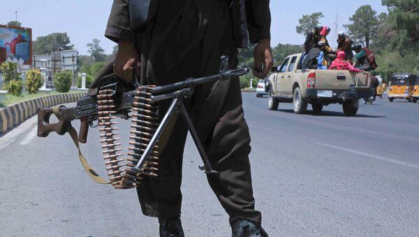 A Taliban fighter stands guard on a street in Herat on August 14, 2021 - Sputnik International