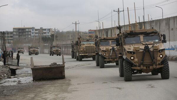 In this file photo dated Wednesday, March 25, 2020, British troops with NATO-led Resolute Support Mission forces travel, in Kabul, Afghanistan. Dozens of former military commanders are calling on the U.K. government to relocate more of the Afghans who worked with British troops over the last 20 years, arguing that they are likely to be murdered by the Taliban as foreign forces pull out. Retired Gen. Richard Dannatt, the former chief of the General Staff, and other senior leaders of the campaign in Afghanistan, are urging the government to expand its relocation program to include interpreters and other support staff who were dismissed for minor infractions.  - Sputnik International