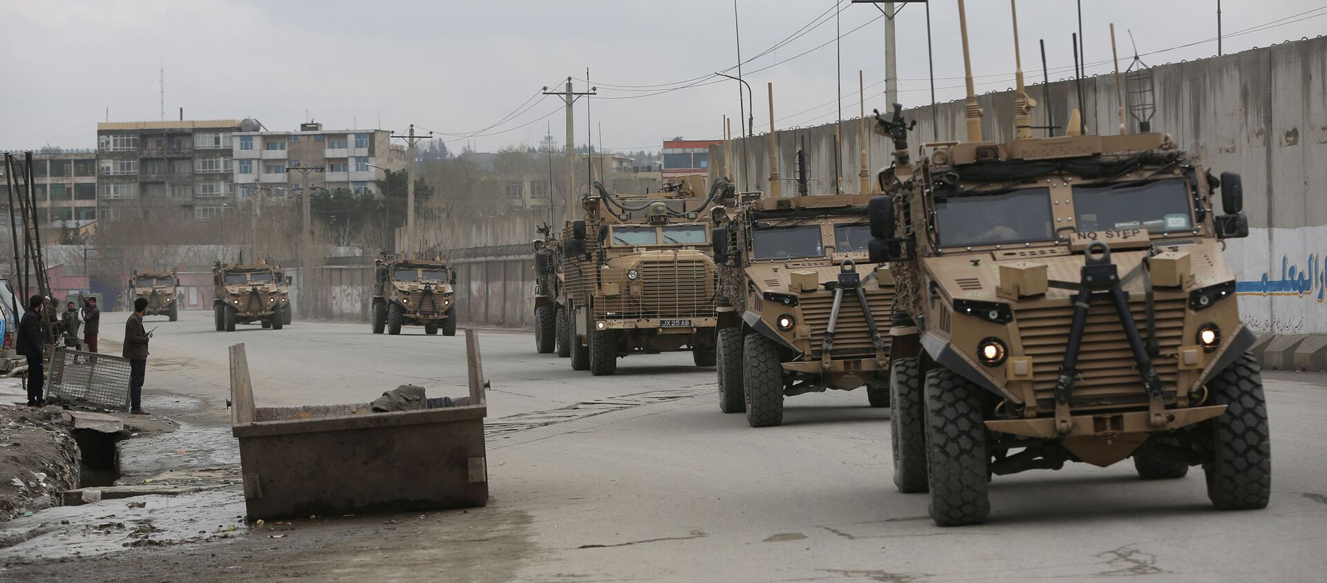 In this file photo dated Wednesday, March 25, 2020, British troops with NATO-led Resolute Support Mission forces travel, in Kabul, Afghanistan. Dozens of former military commanders are calling on the U.K. government to relocate more of the Afghans who worked with British troops over the last 20 years, arguing that they are likely to be murdered by the Taliban as foreign forces pull out. Retired Gen. Richard Dannatt, the former chief of the General Staff, and other senior leaders of the campaign in Afghanistan, are urging the government to expand its relocation program to include interpreters and other support staff who were dismissed for minor infractions.  - Sputnik International, 1920, 14.08.2021
