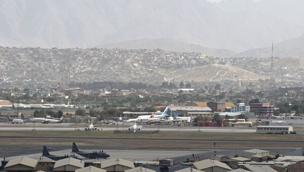 This picture taken on August 14, 2021 shows aircrafts standing on the tarmac of the airport in Kabul. - Sputnik International