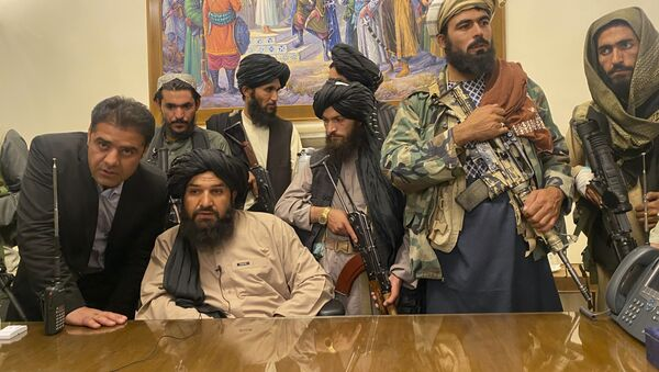 Taliban fighters take control of Afghan presidential palace after the Afghan President Ashraf Ghani fled the country, in Kabul, Afghanistan, Sunday, Aug. 15, 2021. - Sputnik International