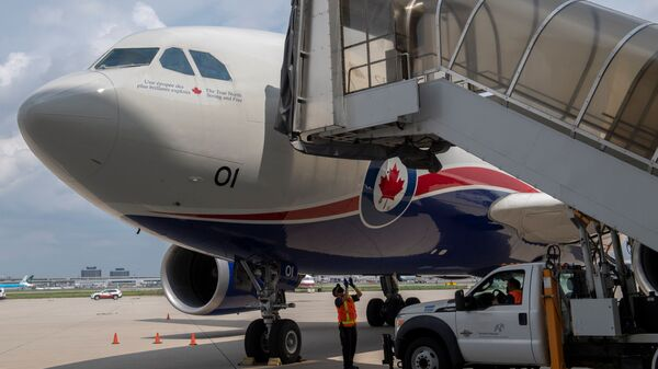 A Canadian Armed Forces CC-150 Polaris aircraft carrying Afghan refugees who supported Canada's mission in Afghanistan arrives at Toronto Pearson International Airport in Mississauga, Ontario, Canada August 13, 2021. Picture taken August 13, 2021.  - Sputnik International