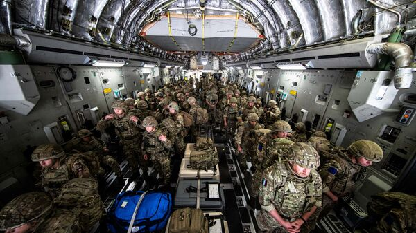 British Forces from 16 Air Assault Brigade arrive in Kabul, Afghanistan, to provide support to British nationals leaving the country, as part of Operation PITTING after Taliban insurgents took control of the presidential palace in Kabul, August 15, 2021. Leading Hand Ben Shread/RAF/UK Ministry of Defence 2021/Handout via REUTERS   THIS IMAGE HAS BEEN SUPPLIED BY A THIRD PARTY. - Sputnik International