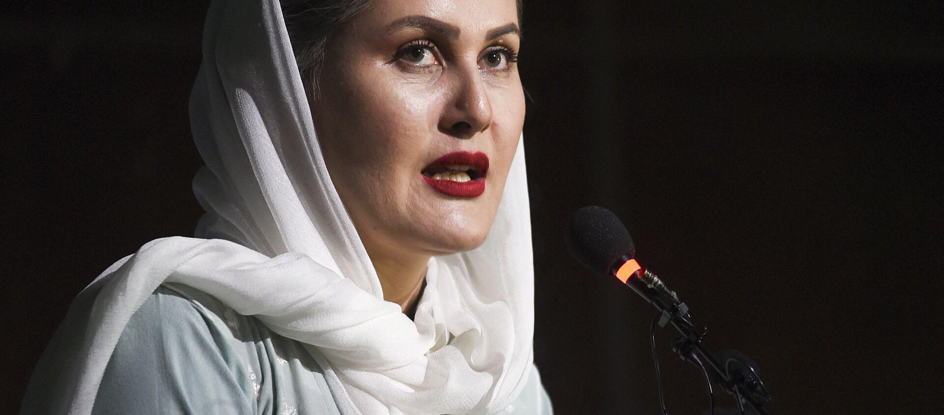 In this photo taken on August 3, 2019, movie director Sahraa Karimi speaks during the Afghan Film Festival opening at Kabul University in Kabul - Sputnik International, 1920