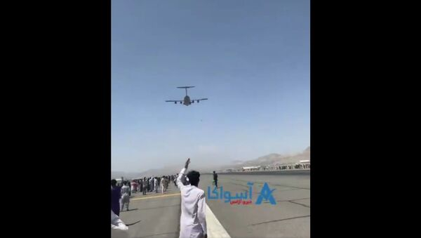 Exclusive- A clear video (from other angle) of men falling from C-17. They were Clinging to some parts of the plane that took off from Kabul airport today.  - Sputnik International