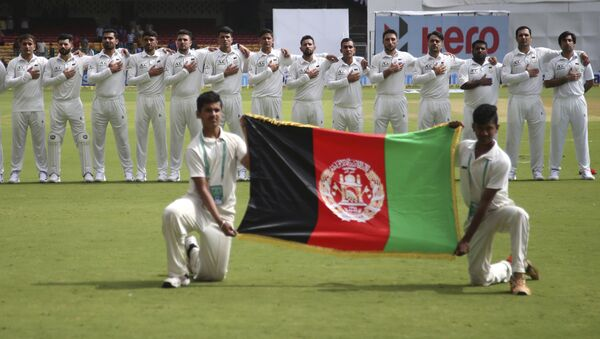 Members of Afghanistan cricket team stand for their national anthem before the start of the one-off test match against India in Bangalore, India, Thursday, June 14, 2018 - Sputnik International