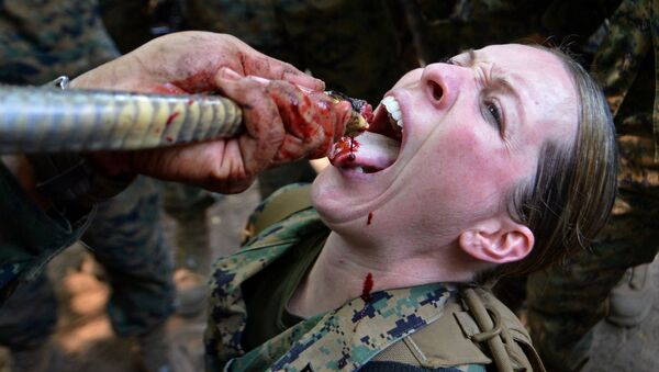 A US Marine drinks cobra blood during a jungle survival program as part of the annual combined military exercises, Cobra Gold 2013, at a navy base in Sattahip on February 20, 2013 - Sputnik International