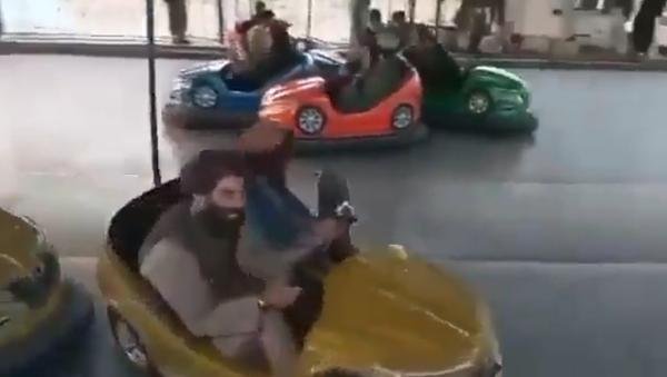 Screenshot: Alleged Taliban militants in an amusement park - Sputnik International