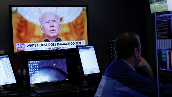An image of U.S. President Joe Biden is broadcast on a screen after his address to the nation regarding the situation in Afghanistan as traders work on the trading floor of the New York Stock Exchange (NYSE) in Manhattan, New York City, U.S., August 17, 2021. - Sputnik International