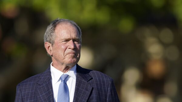 Former President George W. Bush listens to speakers during the opening ceremony of the Walker Cup golf tournament, which starts tomorrow, at Seminole Golf Club in Juno Beach, Fla., Friday, May 7, 2021. The tournament was founded by George Herbert Walker, the United States Golf Association president in 1920, who was the great-grandfather of Bush. - Sputnik International