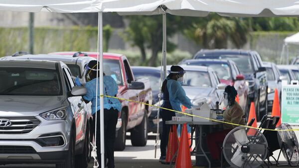 People wait in cars to get a COVID-19 test, Wednesday, Aug. 11, 2021, in Miami. COVID-19 has strained some Florida hospitals so much that ambulance services and fire departments can no longer respond as usual to every call. - Sputnik International