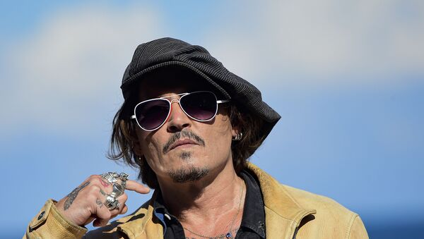 In this file photo dated Sunday, Sept. 20, 2020, US actor and film producer Johnny Deep during the photocall for his film Crock of Gold: A Few Rounds with Shane Macgoman at the 68th San Sebastian Film Festival, in San Sebastian, northern Spain - Sputnik International