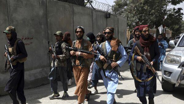Taliban fighters patrol in Wazir Akbar Khan neighborhood in the city of Kabul, Afghanistan, Wednesday, Aug. 18, 2021. - Sputnik International