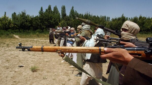 Taliban fighters train with their weapons in an undisclosed location in Afghanistan July 14, 2009 - Sputnik International