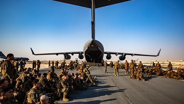 US Marines assigned to the 24th Marine Expeditionary Unit (MEU) await a flight to Kabul, Afghanistan, at Al Udeied Air Base in Qatar, 17 August 2021 - Sputnik International
