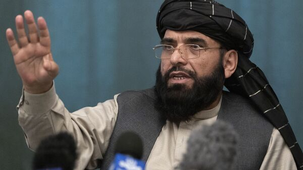 FILE - In this March 19, 2021 file photo, Suhail Shaheen, Afghan Taliban spokesman and a member of the negotiation team gestures while speaking during a joint news conference in Moscow, Russia. In an interview with The Associated Press Thursday, July 22, 2021 - Sputnik International