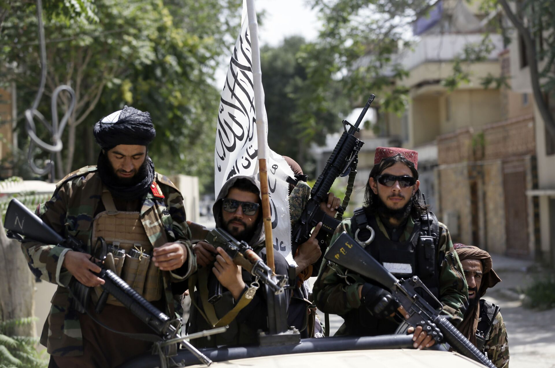 In this Aug. 19, 2021 file photo, Taliban fighters display their flag on patrol in Kabul, Afghanistan. When U.S. President Joe Biden took office early this year, Western allies were falling over themselves to welcome and praise him and hail a new era in trans-Atlantic cooperation. - Sputnik International, 1920, 07.09.2021