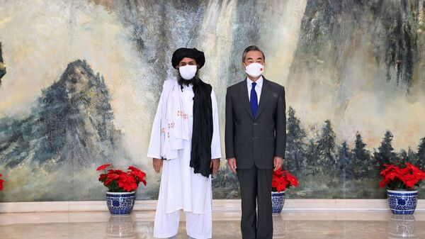 Chinese State Councilor and Foreign Minister Wang Yi meets with Mullah Abdul Ghani Baradar, political chief of Afghanistan's Taliban, in Tianjin, China July 28, 2021. Picture taken July 28, 2021. - Sputnik International
