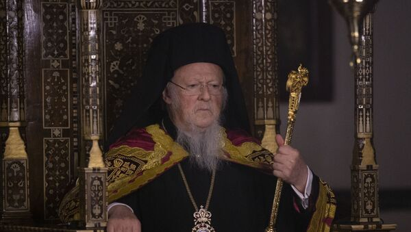 Ecumenical patriarch Bartholomew I , spiritual leader of Greek Orthodox world attends the Easter ceremony during curfew behind the closed doors measures to contain the spread of the coronavirus COVID-19 at the St. George Church in Istanbul on April 18, 2020. - Sputnik International