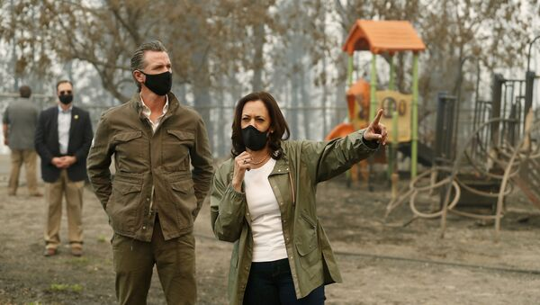 In this Sept. 15, 2020, file photo, California Gov. Gavin Newsom, left, and then Democratic vice presidential candidate Sen. Kamala Harris, D-Calif., talk as they asses the damage during the Creek Fire at Pine Ridge Elementary in Auberry, Calif.   Harris will address California Democratic Party activists on Saturday, May 1, 2021, her first time speaking at the party's annual convention as the second highest office holder in the country - Sputnik International