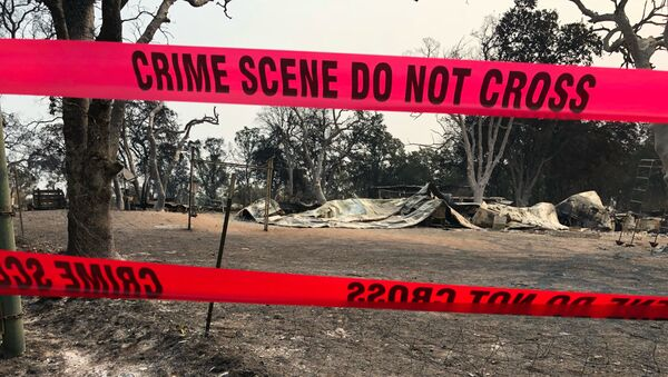 Police tape blocks the house where relatives say three people were found dead following a wildfire in Redding, Calif., Saturday, July 28, 2018.  - Sputnik International