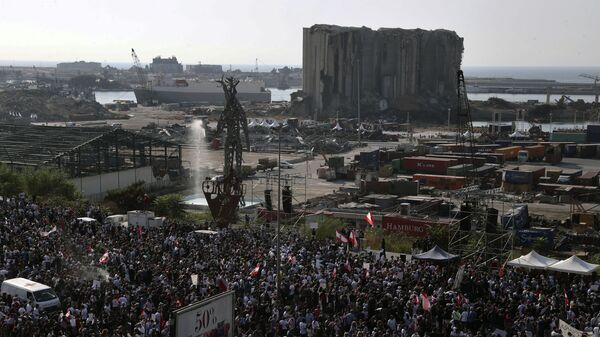 People gather outside the port to mark the first anniversary of the massive blast at Beirut's port, in Beirut, Lebanon, Wednesday, Aug. 4, 2021. - Sputnik International
