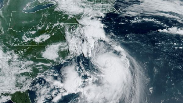 A satellite image shows Tropical Storm Henri over the Atlantic Ocean and approaching the east coast of the United States August 21, 2021.  - Sputnik International