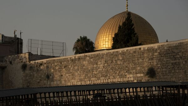The Dome of the Rock mosque is seen above the Mughrabi Bridge, a wooden pedestrian bridge connecting the wall to the Al Aqsa Mosque compound, in Jerusalem's Old City, Tuesday, July 20, 2021. - Sputnik International